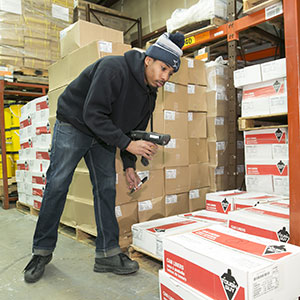 employee stacking boxes