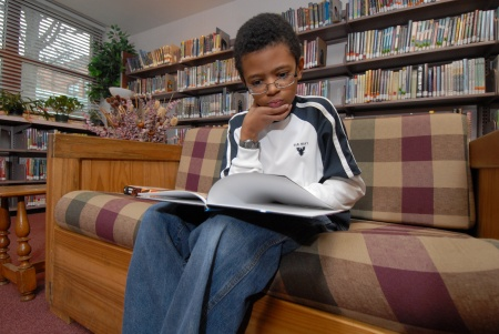 Middle school student in library media center