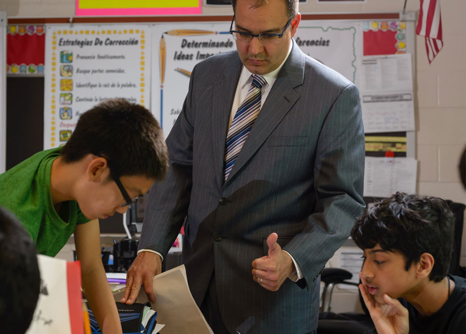 a teacher working with middleschool students